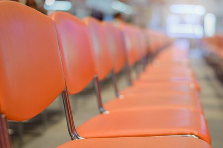 Close up Row of blank chairs in seminar room. seats in an empty conference room 版權商用圖片