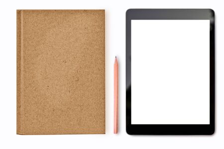 Digital tablet mock up on white background with notebook pencil stationary of student or business man copy space on blank screen easy replace you design.