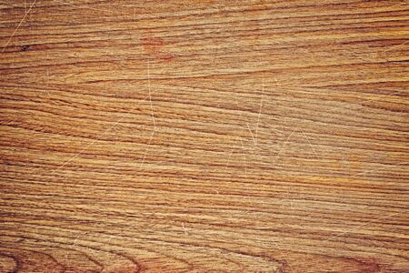 Old wood office table top with scratch texture for background design