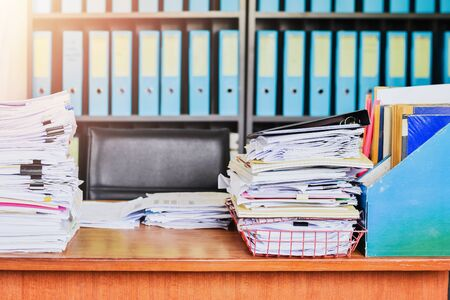 Heap of paper work documents stack on office desk ,business documents billing and examination to report the summary results annual report for presented. Business offices concept closeup