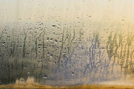 Rain drops on old window glasses natural pattern of raindrops background Фото со стока