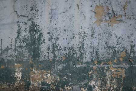 Old and worn out wall background with paint peeling off , Grunge texture of building in a state of disrepair or ruin as a result of age or neglect Stock Photo