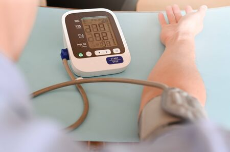 Blood pressure health check High Blood Pressure checking blood pressure of the patient in hospital, selective focus.