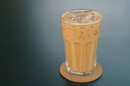Cold coffee in glass on the dark table in cafe
