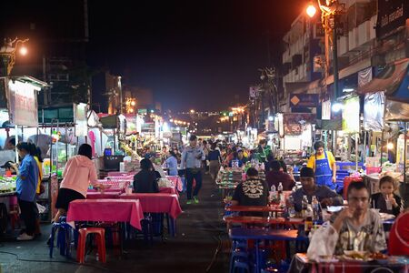 Khon Kaen, THAILAND - January 2020: Local people sell and eating at street food traditional Thai food and drinks at night market in Khon Kaen, Thailand.