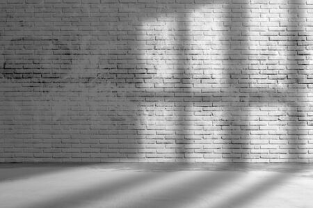 Old grunge rough dark gray brick wall wall with window shadow and concrete floor texture background. Stock fotó