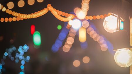 Colorful night lights blurred abstract bokeh farewell party lights from colorful light bulb for your festival Event or Party design backdrop.