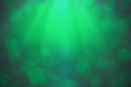 ST Patricks day background green clover leaf bokeh lights defocused for ST Patricks day celebration design background.