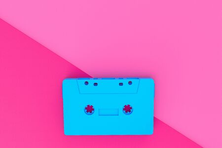 Blue cassette tape on against a pink background in flat style, 3D illustration