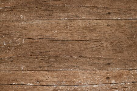Wood texture background.Top view of weathered vintage wooden table top with cracks. Brown rustic rough wood texture and pattern for backdrop.