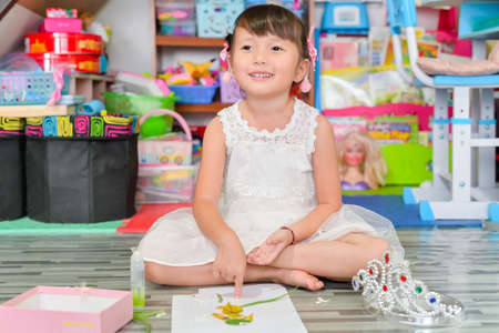 Child little girl play toys disorderly mess in living room a dirty or untidy state of toy and doll at home