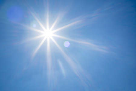 sunbeam blue sky. Bright midday sun ray illuminates the space for overlay nature background