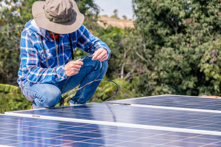 man installing connect power solar panels on a roof house for alternative energy photovoltaic safe energy. power from nature sun power solar cell generator.