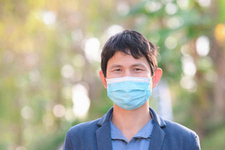 Man wearing a cloth mask in public area protect himself from risk of disease, people prevent infection from  virus   or Air pollution Banque d'images
