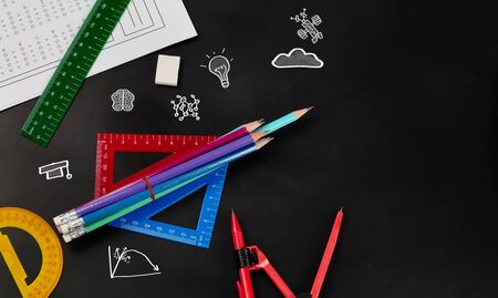 Education and back to school concept. Top view school supplies over chalkboard background in classroom . copy space.