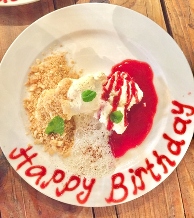 Deconstruction cheese cake with happy birthday text Stock Photo