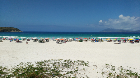 Fort beach with blue water bathers and white sand