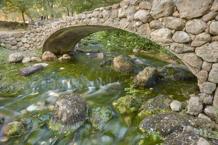 stone bridge over the source of the Cerzo river in Villanueva del Rosario, Málaga. Spain 写真素材