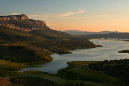 head of the Guadalhorce reservoir at sunset, in the Guadalteba region in Malaga. Spain