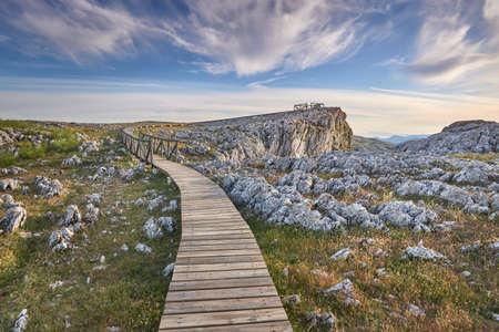 Wooden walkway for public use over the limestone rock landscape in Loja, Granada. Spain