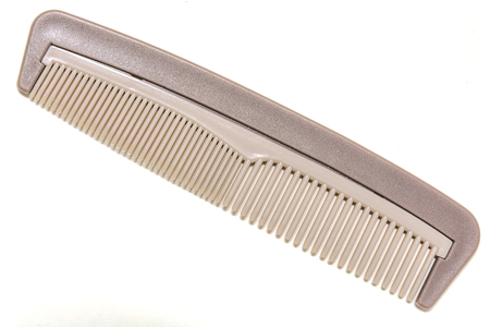 mans comb. close up. on white background.