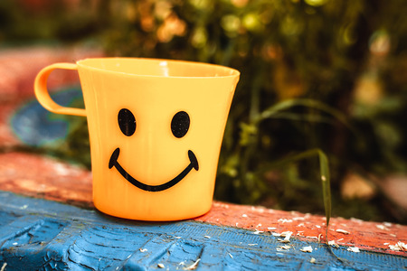 pleasantness: Yellow circle with a smile Stock Photo