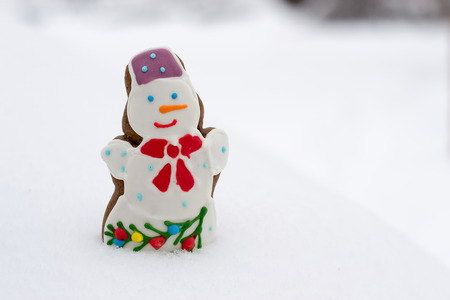 delicious fun snowman cookies cobbled together out of the snow photo