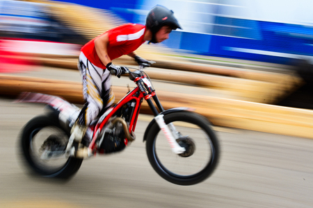 greased: Yoshkar-Ola, Russia - August 09, 2015 Unidentifiable Enduro motorcycle discipline rider greased while driving at high speed