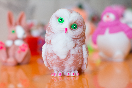 Decorative handmade soap in the form of a sweet owl figurine Stock Photo