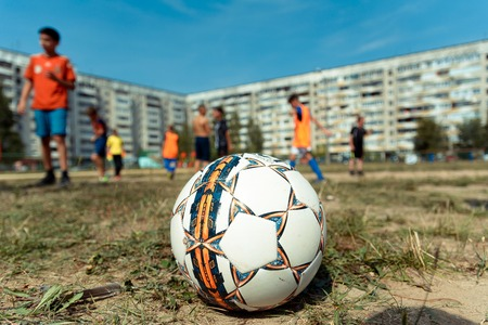 Yoshkar-Ola, Russia - August 20, 2016 A soccer ball during a game of street football on one of the yards in Yoshkar-Ola