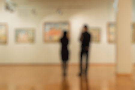 Abstract image of people in the lobby of a art center with a blurred background