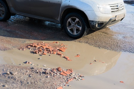 Hole in the asphalt, bad road Editorial