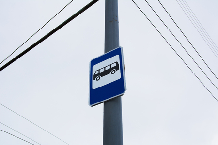 Road sign bus stop on a pole Imagens