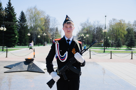 The guard of honor with a Kalashnikov rifle Editorial