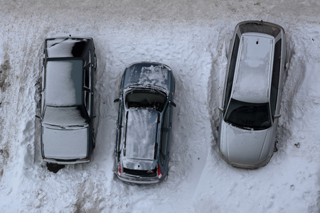 Snow-covered car in the parking 스톡 콘텐츠 - 124658225