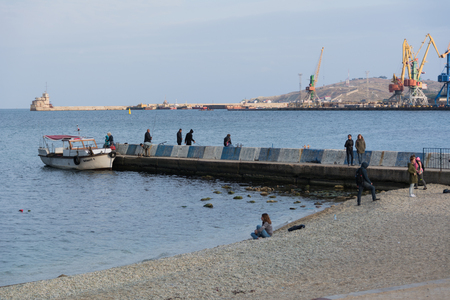 View of the pier on the beach of Feodosia Editorial