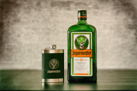 Yoshkar-Ola, Russia - February 15, 2018 Jagermeister, German digestif made with 56 herbs and spices is the flagship product of Mast-Jagermeister SE. Retro styling.