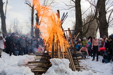 Yoshkar-Ola, Russia - February 26, 2017 Maslenitsa celebration. The ritual of burning the scarecrow of maslenitsa on the stage of the city park