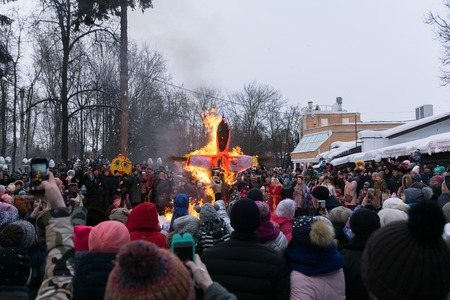 Yoshkar-Ola, Russia - Feb 18, 2018 Maslenitsa fest. Burning Maslenitsa Lady and crowd people