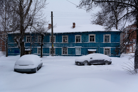 Yoshkar-Ola, Russia - February 10, 2018 Old emergency residential house covered with snow, after a heavy snowfall