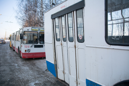 Yoshkar-Ola, Russia - February 15, 2018 Photo ZiU-682 is a Soviet Russian high-floor trolley bus of large capacity for intraurban passenger traffic. The back of the trolley with the entrance door. Russian trolleybuses