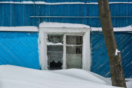 Architectural detail of snow and ice covered window