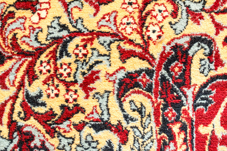 Fragment of retro tapestry fabric pattern with colorful floral ornament on white background. Imagens