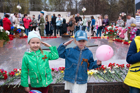 Children salute in the background Editorial