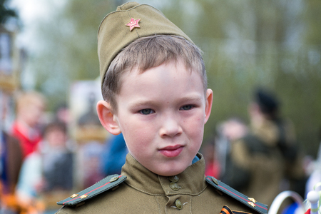 Children in uniform, soldiers and the defenders