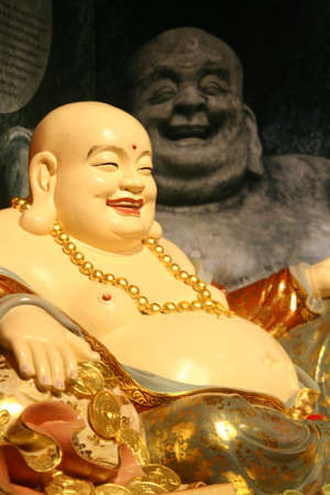 Statue of a laughing Buddha. Stock Photo