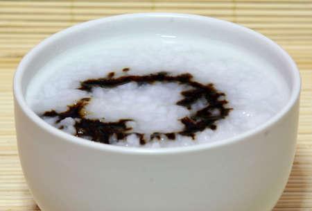 Local plain porridge with dark soya sauce.