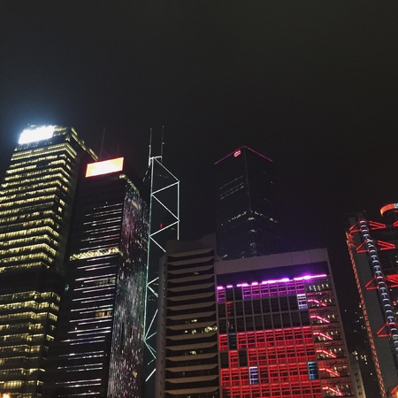 high rise buildings in a city at night