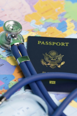 travel medicine concept with passport and stethoscope