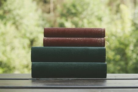 Old books on a garden table Stock Photo